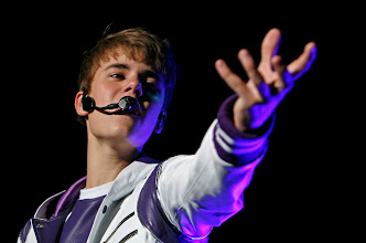 """Photo: Pop sensation Justin Bieber performs during his """"My World Tour"""" concert at Foro Sol in Mexico City, Saturday Oct. 1, 2011. (AP Photo/Marco Ugarte)"""