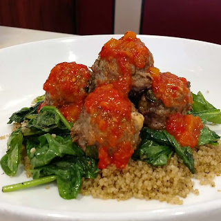 Lamb Meatballs with Quinoa and Roasted Red Pepper Sauce.