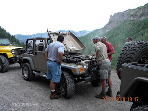 Photo: Old Brown had a Hiccup during one of the first trips, but the MEN quickly fixed the prob and we were back on the road in NO TIME! Jeepers take on mechanical difficulties with a different attitude. Everyone pitches in most of the time it can be fixed or rig so that the adventure continues on!