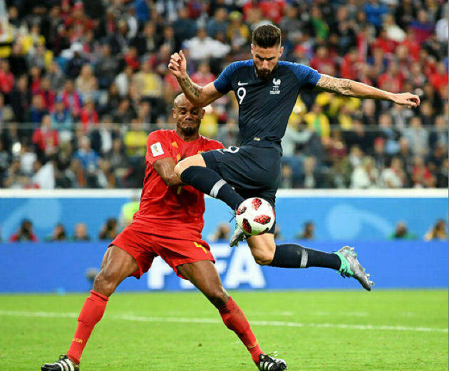 Olivier Giroud of France controls the ball, in front of Vincent Kompany, during the World Cup semifinal match against Belgium at the St Petersburg Stadium