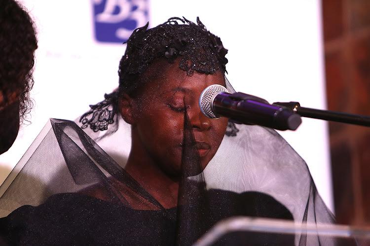 Bob Mabena's wife Eucharist.