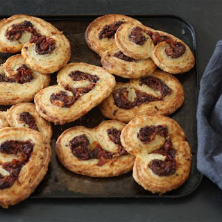 Goats' cheese, black olive and Parma ham pin-wheel palmiers.