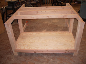 Photo: The shelf is rabbeted into the edge of the lower stretchers to prevent wear on the edges of the plywood shelf.