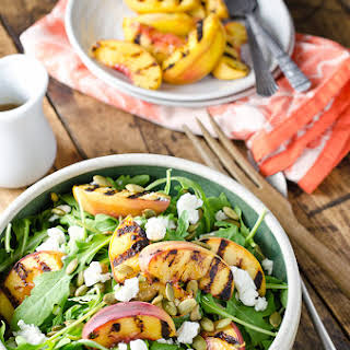 Grilled Peach and Arugula Salad with Goat Cheese and Sweet Honey Balsamic Dressing.