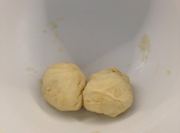 Divide dough into 16 rolled balls and cover with a damp paper towel. Keep...