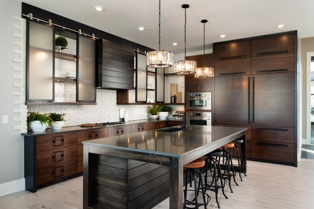 modern kitchen with mahogany island and matching cabinets. glass pendant lighting is hung over the island and glass front cabinet doors add extra storage