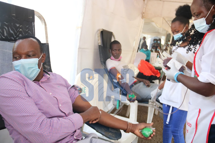Kenyans donating blood during an exercise held by Kenya National Blood Transfusion Service in partnership with the coalition for blood Africa (CoBA) at Uhuru Park Nairobi on Monday, 8 March. /WILFRED NYANGARESI