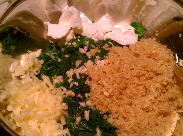 Add kale, cooked quinoa, garlic, cream cheese, and cheddar to the mixing bowl. Stir...