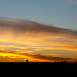 Couple walking on the dam by Gayle Mittan - Landscapes Cloud Formations ( sky, walking, sunset, silhouette, nebraska, clouds, evening, lake, colorful, summer,  )