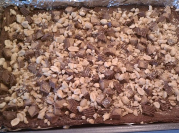 After brownies have baked for 20-25 minutes, top with the chopped peanut butter cups...