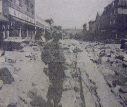 Photo: A National Guard member stands guard in the early days following the flood.