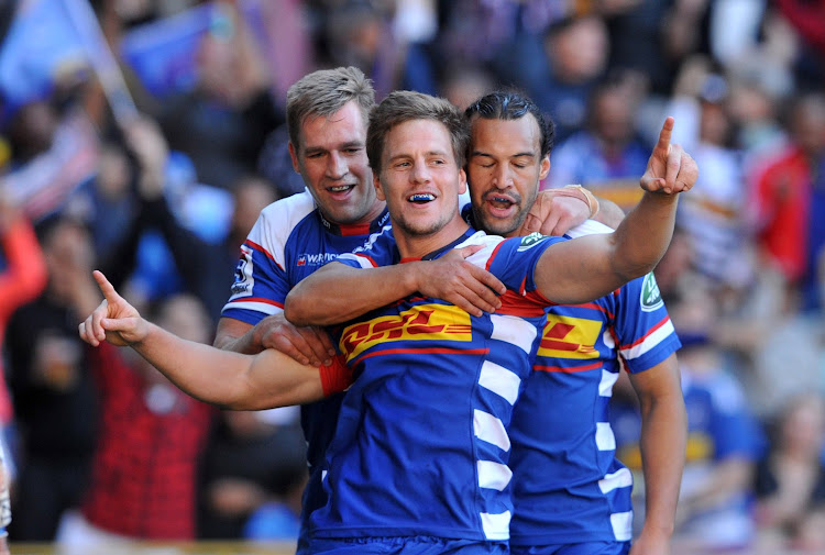 SP Marais of the Stormers celebrates his try with teammates Chris Van Zyl and Dillyn Leyds during the 2018 Super Rugby game between the Stormers and the Bulls at Newlands Rugby Stadium, Cape Town on 5 May 2018 .