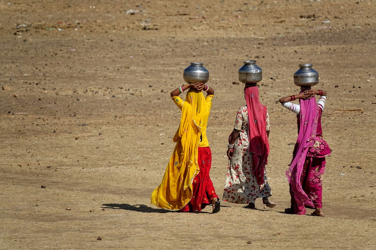 India. Rajasthan Thar Desert Camel Trek. Women bringing water back to the village