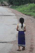 Photo: Mergaitė ant kelio viename mažame kaimelyje.   A girl on one of the roads in a tiny village.