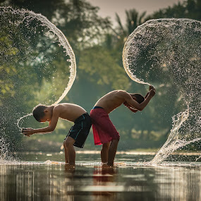 by Visoot Uthairam - People Street & Candids ( countryside, laos, person, splash, joy, thailand, children, recreation, space, rustic, people, sun, kid, caucasian, asian, friends, life, family, indonesia, muscles, lifestyle, boys, asia, france )