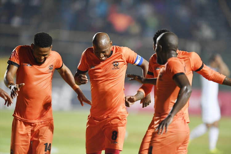 Polokwane City midfielder and captain Jabu Maluleke celebrates with teammates after scoring a stunning free kick during the 1-0 away win over Bidvest Wits at Bidvest Stadium in Johannesburg on Friday September 21, 2018.