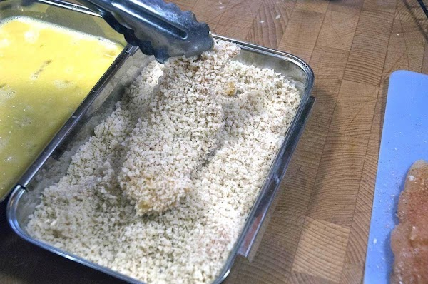 Place into the panko breadcrumbs, and press the crumbs into the chicken.