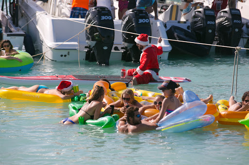 Santa-joins-boat-party.jpg - Santa Claus joins a boat party in Antigua by paddleboard.
