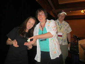 Photo: Goofing with Dr. Leslie Young of the Southwest Research Institute, with a model of the New Horizons craft -- currently en route to Pluto!