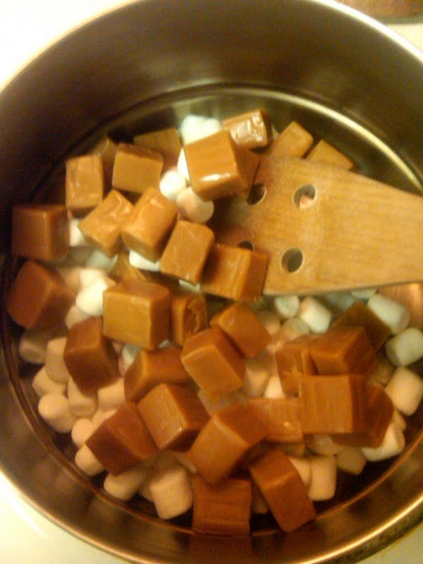 In a medium pan, melt the unwrapped caramels, water, and mini marshmallows together over...