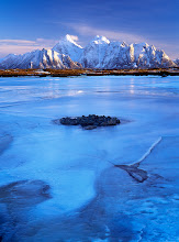 Photo: Photographed in Lofoten, Norway.  Winter in Lofoten can be highly rewarding photographically - breathtaking mountain ridges rising out of the water, deserted, bold and silent scenes, amazing lighting that often dramatically changes.  This is one of the very first images made after landing there. Hence perhaps more descriptive than what I wished it to be but it's been natural and obvious subject before I got deeper into understanding the landscape. Here, I liked the gentle touch of blue hues all over the frame, combined with spectacular rock formation that was softly lit by late sun. I used my Hasselblad 6x4.5 equipped with 35mm lens and Fuji Velvia.