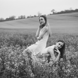 by Vix Paine - Babies & Children Child Portraits ( dancers, pose, rapeseed field, dance photography, child dancer, dance move, ballet, sisters, bare feet, teenagers, flower, dancer, working together, rapeseed, black and white, family, sister, child, teenager )