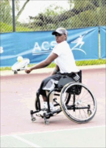 ON THE BALL: South Africa's number one woman wheelchair tennis player, Kgothatso Montjane, shows what it takes to succed.  Cicra 2008. Pic. Unknown