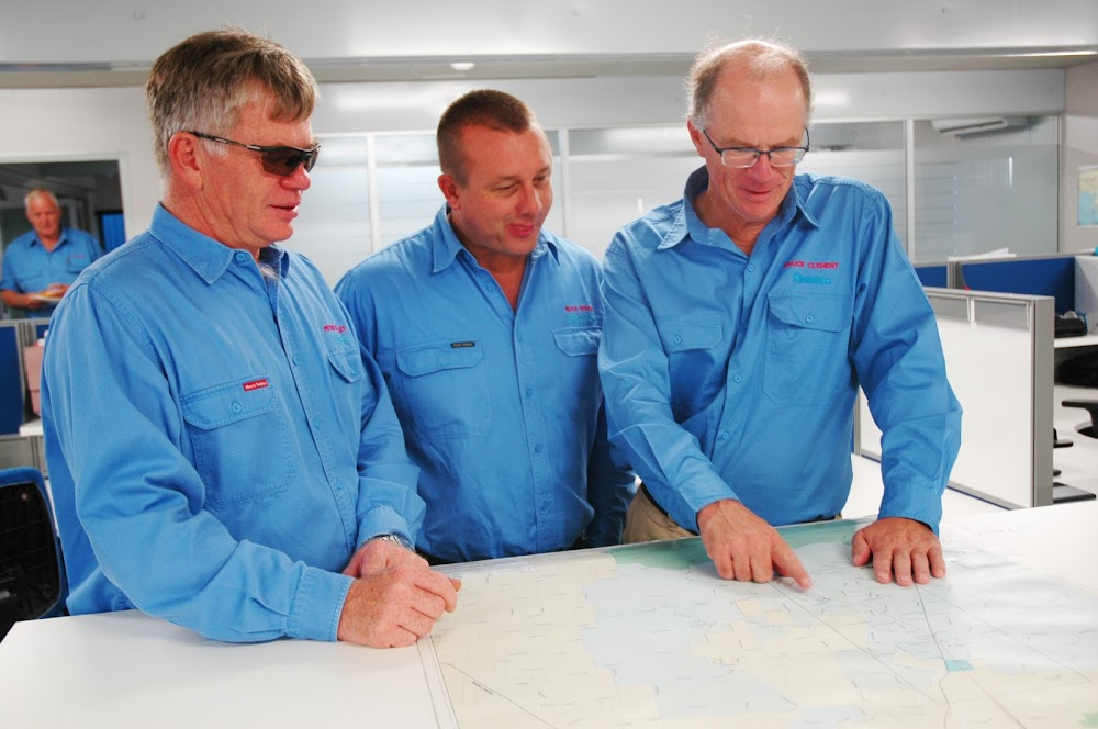 Familiarisation: Santos general manager of energy NSW Peter Mitchley and environment and water manager Neale House look over a map of the Narrabri Gas Project with vice president NSW, Asia and WA oil Bruce Clement before the latter toured the project for the first time this morning.