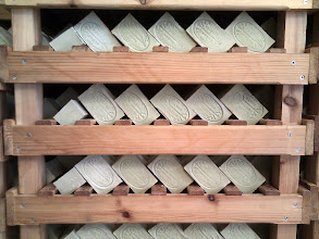 Photo: Bars of soap maturing on racks