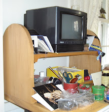 Photo: This simple TV stand was made from poplar, an inexpensive easy to work and finish hardwood. A few design details improve the result from a peach crate, to something nice. It was sized slightly narrower than the table to minimize the chance of being pushed off the edge. The bottom shelf adds strength, and safety should the stand be bumped. Anything that relieves the abundant straight lines and 90-degree angles makes for a nicer result. Here the sides end with a round top. The semi-circle is centered slightly above the top shelf, which softens the straight line there. The front lip (of poplar) on each shelf is finished with a small quarter arch at each end. This softens the line and hides the cleats that supports for each shelf. It also hides the different wood used for th shelf. The joints are all butt, with glue and screws. Next time I would use a stopped dado in the front, or biscuits. Failing to pre-drill the screw holes caused one side to split. In spite of this, it is a piece we continue to use.
