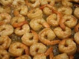 on a stove top, heat skillet over medium high heat, clean and deveined shrimp,...