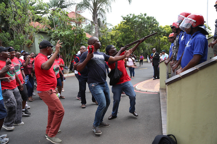 Striking DUT staff protest outside the Vice Chancellors office in Durban as Mi7 security block access to the building. File photo.