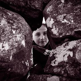 Fiona looking through the dyke by Morag Soszka - Babies & Children Child Portraits ( scotland, sutherland, ardgay, croick estate, dry stone dyke )