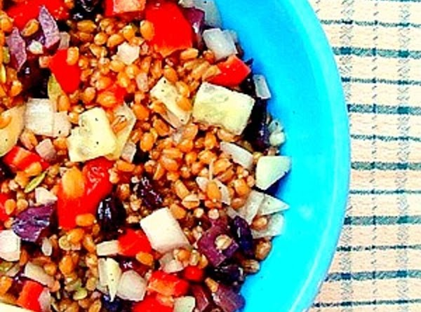Combine the wheat berries, water and a pinch of salt into a sauce pan....
