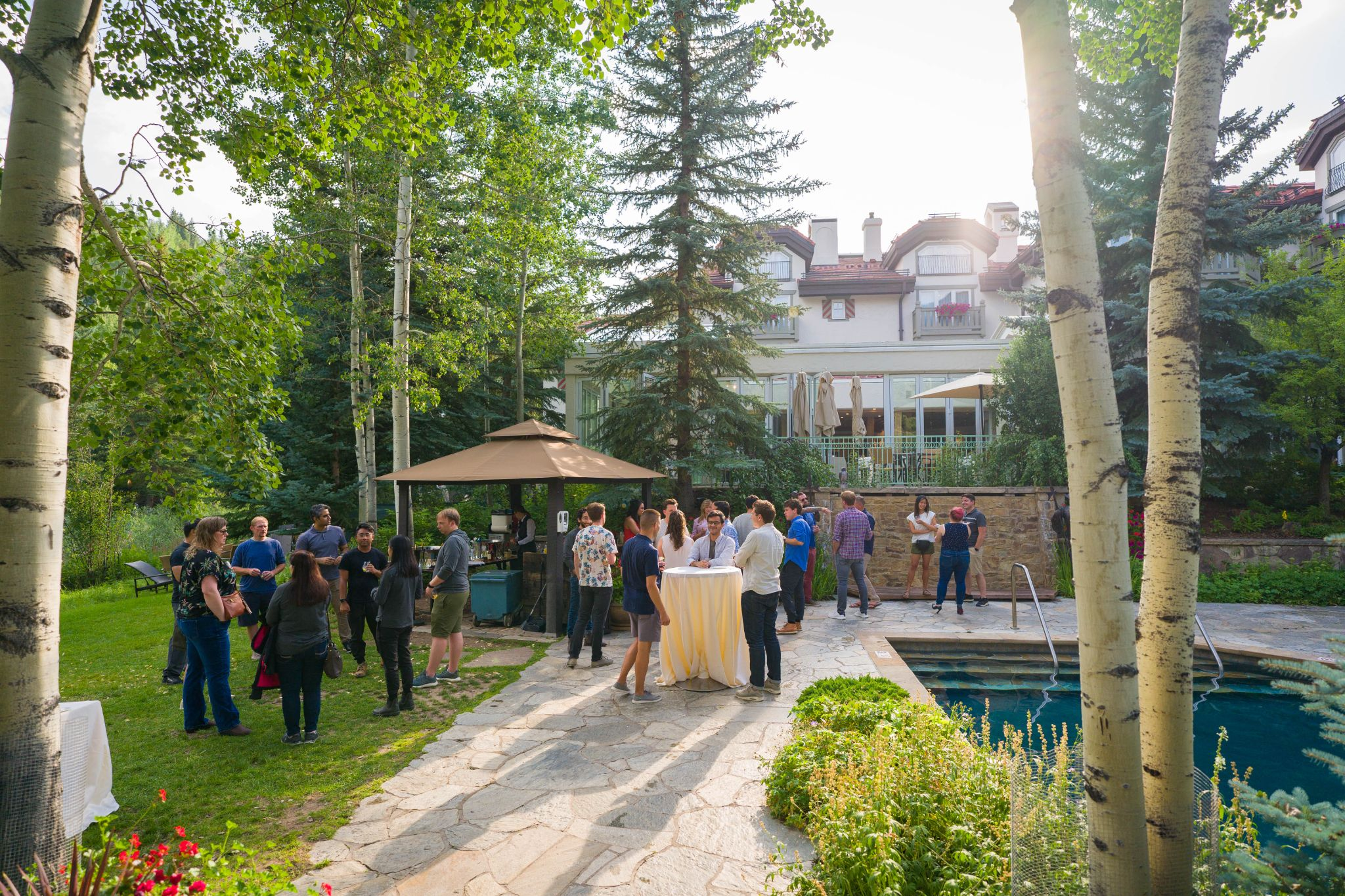 Group of people outside enjoying happy hour_pathpoint corporate retreat_flok
