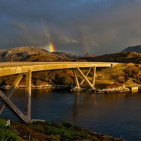 Double rainbow over bridge by Peter Luxem - Buildings & Architecture Bridges & Suspended Structures ( dark clouds, bridge, gold, rainbow, pwcbridges )
