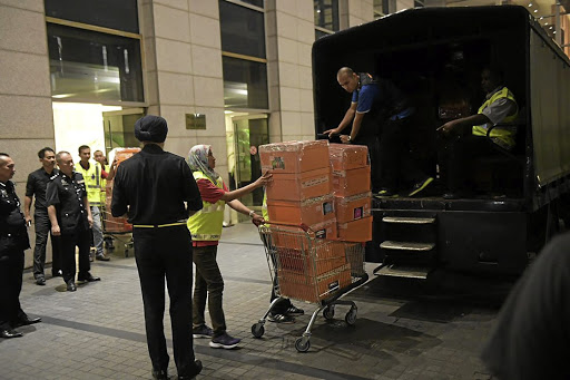 Malaysian police officers raid apartments owned by former Malaysian prime minister Najib Razak's family, in Kuala Lumpur, on May 17 2018. Picture: STRAITS TIMES VIA REUTERS