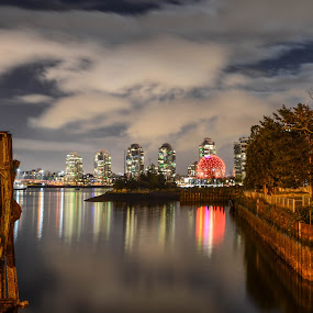 Vancouver's False Creek area at night by Cory Bohnenkamp - City,  Street & Park  Skylines ( skyline, false creek, burrard inlet, night, pilings, vancouver )