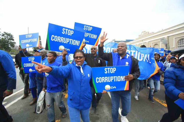 DA members march against corruption.