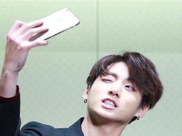 Jungkook taking a selfie.