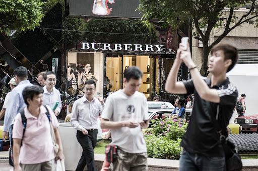 Pedestrians walk past a Burberry store in the Causeway Bay shopping district of Hong Kong. Picture: BLOOMBERG/XAUME OLLEROS