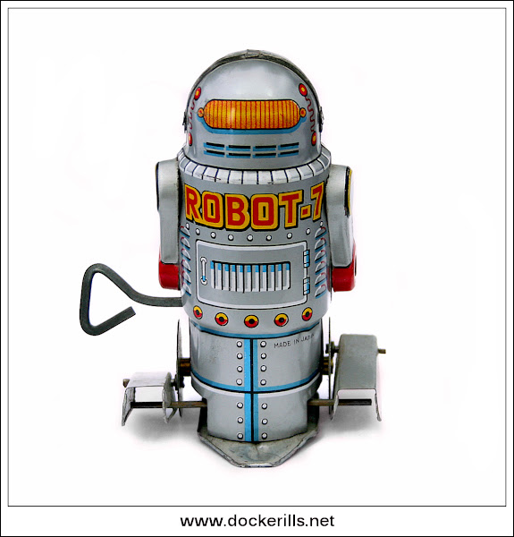 "Photo: Yoneya ""Robot-7"", Japan. (Picture 2 of 2) See also Noguchi.  Tinplate / W/U / Fixed key. Paddle foot robot.  Visit my blog - Collecting Tin Toys at  http://tinplatetoys.blogspot.co.uk/"