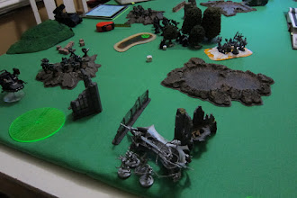 Photo: Turn 1 - end of Dark Angel turn - Dark Angel missiles from the Land Speeder and ground troops wreck the Raider carrying 10 Wyches, the Wyches must move on foot. They pass their pinning test and prepare to assault!