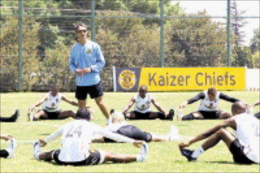 STRETCHED: Kaizer Chiefs' coach Muhsin Ertugal takes his charges through training at Naturena in Johannesburg yesterday. Pic. Mohau Mofokeng. 14/10/2008. © Sowetan.
