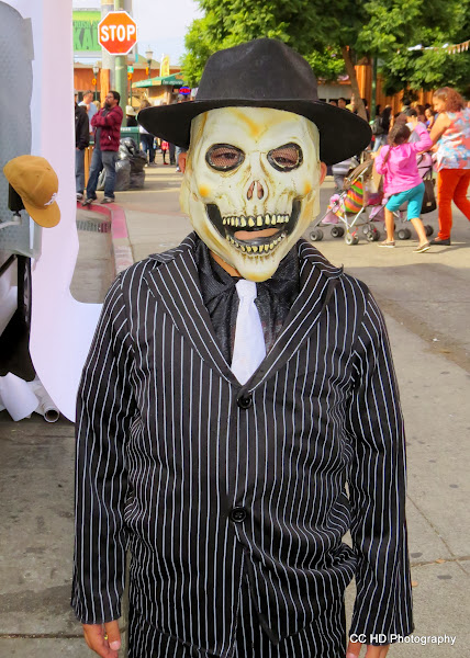 Photo: Dressed up boy makes the rounds.