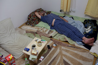 Photo: June 14, 2011. Minami Soma. Having lost his home, Kobayashi now sleeps in a small apartment with few furnishings.