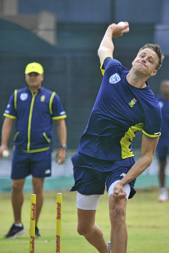 Striker: Morné Morkel at a net session at Newlands in January. Bowling coach Charl Langeveldt, in the background, has hinted at Morkel making a comeback for the Titans next week. Picture: GALLO IMAGES