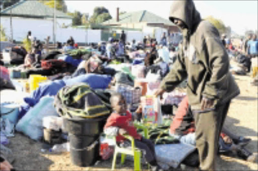 STREET LIFE: Displaced foreigners living on the street after being kicked out of the Lindela repatriation centre. Photo: Peter Mogaki. 27/07/08. © Sowetan.