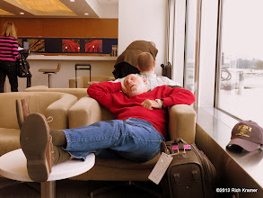 Photo: Waiting at Seatac for our flight to LAX and our redeye to MCO, dad got some shuteye in the Sky Club Lounge.