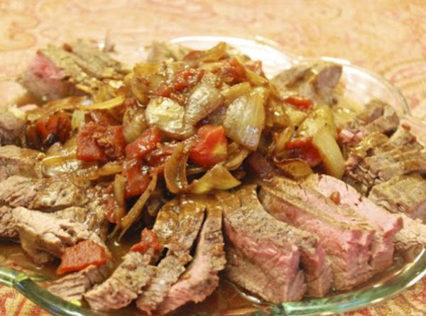 Italian Flank Steak With Onions And Tomatoes In A Recipe